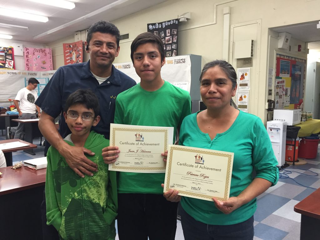 family-gets-their-college-knowlege-certificates